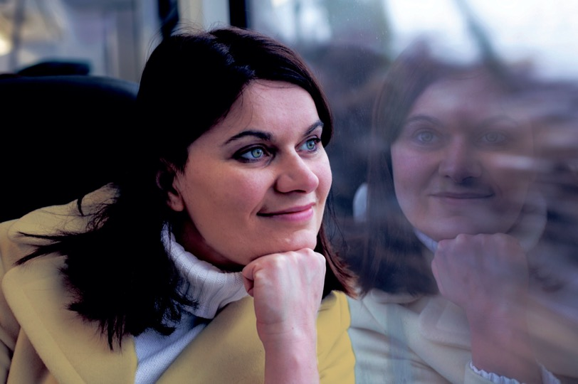 Woman gazes out of train window