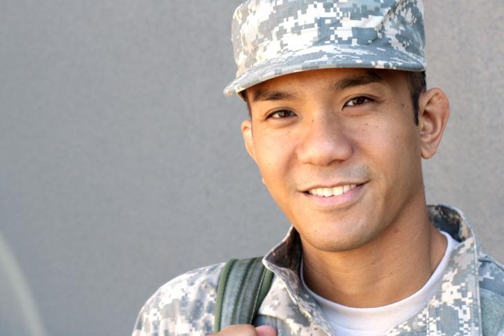 Male soldier smiles at camera