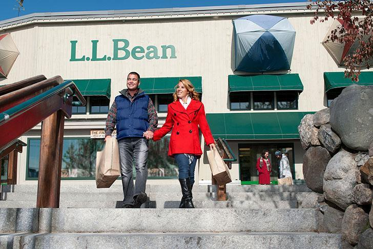 couple walks down steps at LL Bean