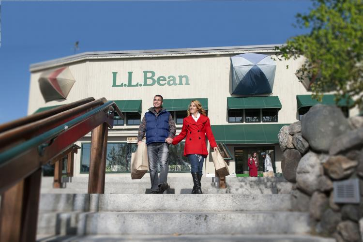 Man and woman walk down steps of LL Bean in Freeport